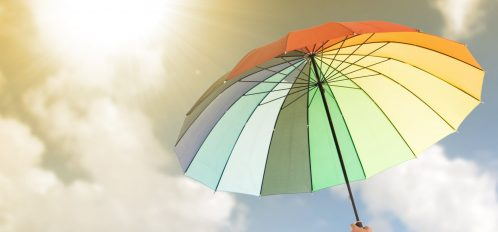 Rainbow colored umbrella; Things to Do at the Beach When it Rains
