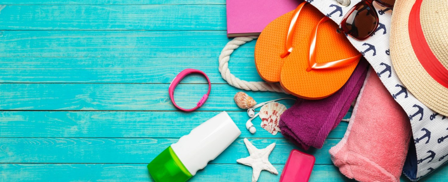 Beach Bag Accessories on a Blue Wooden Table
