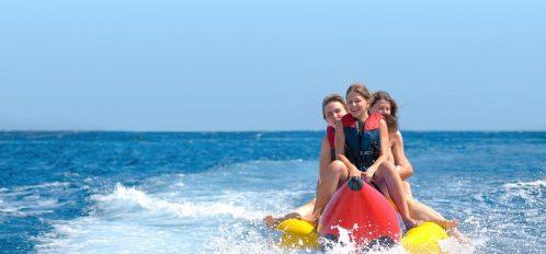 Family riding through the ocean on a Destin boat tour