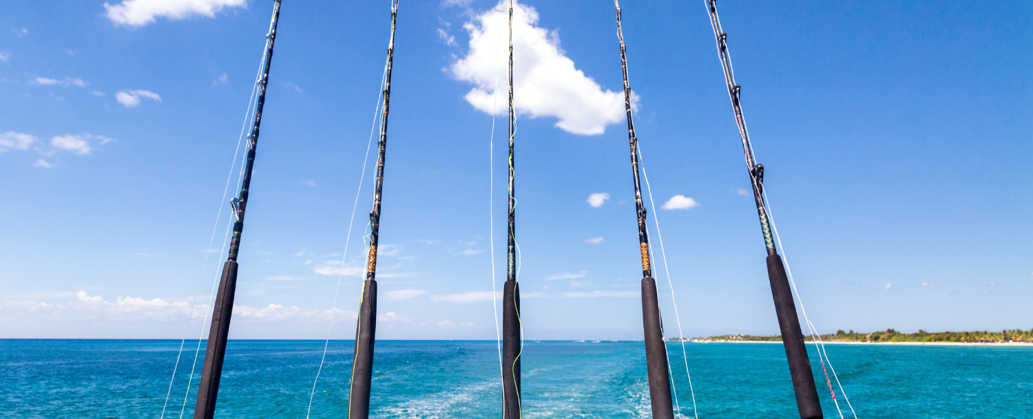 fishing rods attached to a deep sea fishing boat in Destin FL